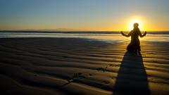 Meditating (Kathrin & Stefan) Tags: ocean sunset newzealand sky beach nature silhouette backlight island sand outdoor southisland tasmansea nzl invercargill rakiura stewartisland foveauxstrait oretibeach kathrinmarks