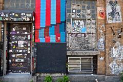 Brooklyn Wall (Ben Shoosmith) Tags: door nyc usa ny newyork window wall brooklyn america graffiti us bricks stickers pipes