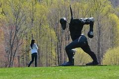 Woman Confronts The Striding Figure (Joe Shlabotnik) Tags: sculpture man art stormking crop figure faved striding 2013 thomashouseago april2013