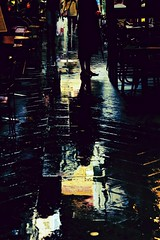 The Rainy Cafe Terrace (anna cate (been MIA)) Tags: urban rain reflections melbourne lane pedestrians laneway 60mm f56 footpath cafes annacate peopleandpaths