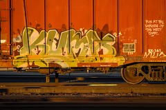 KUMA (TheLost&Found) Tags: light urban sun west art fall beautiful minnesota train bench photography graffiti golden evening coast paint king painted exploring minneapolis trains explore hour boxcar graff burner freight rolling kuma freights benched 2013
