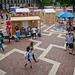 The Brickyard is active as students stroll past the shacks constructed September 23.