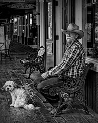 Watchin' the world go by (Ray Kellett) Tags: dog southdakota blackwhite cowboy olympus keystone omd
