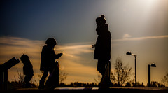Silhouetted family.. (Bhalalhaika) Tags: family blue friends sun fall colors playground oslo norway photography flickr favorites silouette views