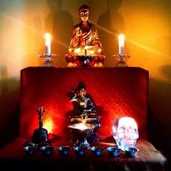 Steven Caldwell from Sydney, Australia, shrine for the Urban Retreat...                   Just down the road from the Sydney Buddhist Centre is our small house. Here's the shrine room where my partner and I meditate. The red cloth is a special one brought