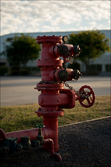 scoresby-3387-ps-w (pw-pix) Tags: blue red sun white building industry water backlight clouds sunrise hydrant grey industrial factory exterior steel painted pipes pipe australia melbourne victoria warehouse valve backlit firefighting tap carpark valves coupling connection caribbeangardens scoresby easternsuburbs outereast dalmoredve