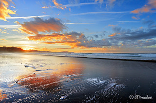beach at sunset with beautiful clouds