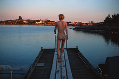 Sauna by the sea, Finland.    (Iurii & Natali) Tags: blue sea summer film water girl night swim vintage suomi finland island evening fuji skin velvia chrome blonde m42 analogue 135 praktica seminude sauna seminaked swimsuite mtl5 yashicon arhepelago