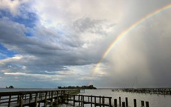 Chasing Rainbows (KM Preston Photography) Tags: sky storm water weather clouds river landscape rainbow day cloudy thunderstorm planetearth indianriver sebastianfl indianrivercounty kmprestonphotography 20160521110305c