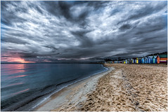 Sunset rolling in (RissaJT_23) Tags: sunset sky people storm beach water clouds sand brighton brightonbeach beachhuts