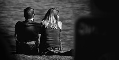 By the Sea (Owen J Fitzpatrick) Tags: ojf people photography nikon fitzpatrick owen j joe street pavement chasing d3100 ireland editorial use only ojfitzpatrick eire dublin republic candid tamron unposed social woman beauty beautiful attractive face blonde view sea pier water behind rear black white bw monochrome blackwhite blackandwhite candidphoto candidphotography smile smiling laugh laughter fun happy twp happiness print fabric man male friendship pair blancoynegro pretoebranco schwarzundweis  hiybi  hi y bi nigra kaj blanka