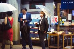 OK Boss, Where Next? (Jon Siegel) Tags: men boys japan umbrella japanese 50mm nikon kyoto suits business 12 charming nikkor cinematography cinematic umbrellas raining businesssuits 50mmf12 d810 nikon50mmf12