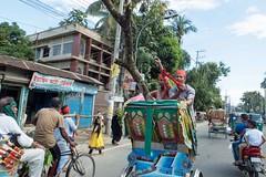 H504_3398 (bandashing) Tags: street red england tree men manchester shrine hill crowd logs rickshaw sylhet bangladesh carry socialdocumentary followers mazar mystics aoa shahjalal bandashing akhtarowaisahmed treecuttingfestival lallalshahjalal