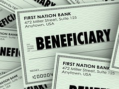 Beneficiary word on checks as payouts of insurance policies or inheritance from a will or trust from (julietkay) Tags: assignee background backgroundcheck beneficiary check designate designated donate donated donee earn entrusted family finance financial get give given giving givingmoney grant grantee heir income inherit inheritance inheriting inheritor insurance insurancepolicy insured money pile pileofmoney policy receive recipient rich survivor trust wealth wealthy whoweare will windfall word