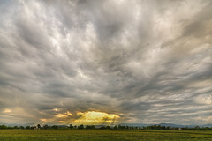 Glimmer Of Hope (Striking Photography by Bo Insogna) Tags: sun foothills west nature landscape golden landscapes scenery colorado view country scenic stormy rockymountains rays plains shining beams extremeweather severeweather stormfront jamesinsogna