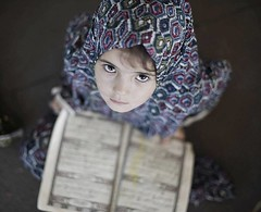 Palestinian girls read the holy Quran in Gaza (TeamPalestina) Tags: reflection canon landscape hope landscapes photo am nice nikon photographer natural live palestine innocent blockade gaza freepalestine palestinian occupation