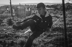 Peligrosas Vallas (pelpis) Tags: portrait people blackandwhite bw childhood children child refugee refugees refugeecamp katsikas refugeechild refugeecrisis katsikascamp