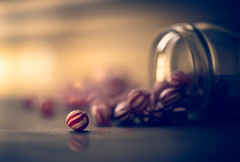 Sweets for the sweetest (cristina.g216) Tags: red stilllife luz backlight contraluz rojo flare jar sweets dulces frasco caramelos