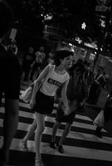 "God ""BLESS"" her. (2 Funky) Tags: street city blackandwhite girl monochrome night tokyo shinjuku walk candid snapshot snap  across   m82  voigtlandernokton35mmf14sc"