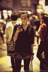 The ubiquitous Japanese girl phone user. (nipponalicat) Tags: portraits japanese tokyo asia asians faces shibuya japanesestyle tokyostyle streetstyle tokyonights japanesepeople 2013 japanesefaces nipponalicat shibuyastreet streetdocumentaryphotography tokyoplaces