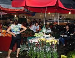 Hanoi . 4 A.M. Flower Market II (Marco Sarli) Tags: life street flowers girls red flower night umbrella market candid vietnam sleepy hanoi