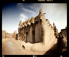 Mosque (tsiklonaut) Tags: africa travel west color colour 120 film architecture analog rural cn design desert pentax kodak drum scanner muslim islam vivid mosque scan semi negative clay experience roll medium format analogue 6x7 mali timbuktu portra vc  67 analogica discover 160  c41  drumscan  timbouctou  djenn     aafrika