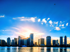 Azure cowboy (Sky Noir) Tags: city travel pink blue sunset sun water sunshine yellow skyline reflections photography coast cityscape bright florida miami jet shoreline azure bigsky fl airliner skynoir