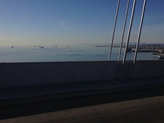 Ships awaiting cargo, or floating storage... (wbaiv) Tags: sf bridge vw island oakland bay back am san francisco driving ship north working riding again commute there yerba passat fromcar 830 buena 580 outwindow 715