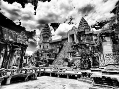 Angkor #9 (wianphoto) Tags: sky blackandwhite statue stone wall clouds temple sandstone asia cambodia khmer cloudy stones highcontrast wideangle olympus structure cairns angkor strongcontrast wideanglelens blackandwhitephoto pl5 insidethetemple olympus918mmm olympuspl5 olympuspenpl5 wianphoto