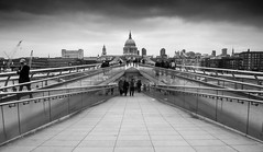 Millenium's End (dolbinator1000) Tags: city uk bridge england sky people white black london glass saint st thames clouds river blackwhite cathedral pauls tourists millennium