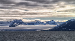 Midnight sun (marko.erman) Tags: sky panorama sun mountains cold ice beautiful norway clouds montagne landscape eau calm glacier svalbard ciel midnight serene nordic polar icy nuage paysage extrieur bore spitzbergen