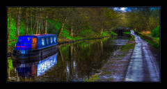 Barge in the Rain (Kevin From Manchester) Tags: bridge trees england building water beautiful architecture canal village historical towpath waterways saddleworth canon1855mm greatermanchester uppermill huddersfieldnarrowcanal kevinwalker canon1100d