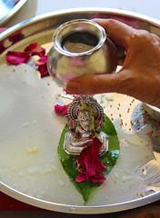 Pooja_Faith (namita t) Tags: india home water rose petals faith belief wash ganesh idol pooja ganapati cleanse