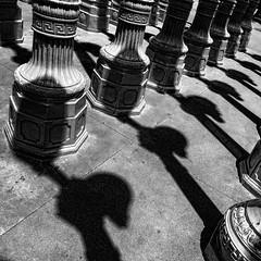 GROUNDED (MacroMarcie) Tags: light shadow art vintage square losangeles shadows patterns lightposts lacma topaz repeating hss urbanlight topazadjust slidersunday