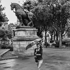 Maidens of the Park (Culture Shlock) Tags: barcelona park girls people rain umbrella walking spain women walk parks stroll maidens strolling walkingintherain