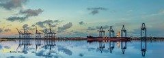 Port Sunrise, Bahamas (Kostas Trovas) Tags: blue sky reflection art water night clouds port sunrise canon landscape lights mirror flickr ship awesome cranes container cropped freeport hdr dockyard tranquillity 6d grandbahamas lr6 500px instagram kostasimages