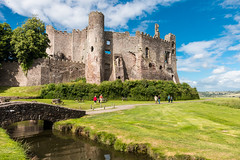 Imposing ruins (Keith in Exeter) Tags: imposing ruin laugharne castle carmarthenshire wales wall fort fortification battlement medieval arrowslit hill tower turret tree bridge river grass outdoor building architecture heritage people leisure