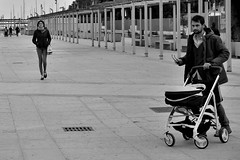 she's coming (Stefano E) Tags: sardegna street boy people blackandwhite italy girl dad italia sardinia gente candid pap cagliari passeggino biancoenero ragazza marinapiccola allaperto