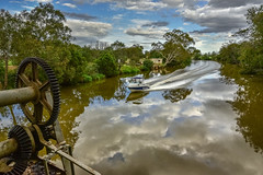 Latrobe River from the Swing Bridge (phunnyfotos) Tags: phunnyfotos australia victoria vic gippsland longford sale river latroberiver reflection reflections boat speedboat wake bridge swingbridge water gear nikon d750 nikond750 cogs gears landscape