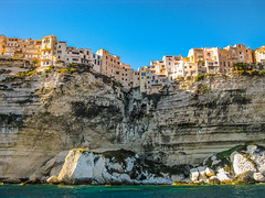 (Voyages Lambert) Tags: city roof sea summer cliff sunlight house mountain france brick tourism rock stone skyline architecture landscape outdoors island town chalk europe cityscape village south hill corsica panoramic limestone ravine exploration gypsum mediterraneansea bonifacio overhanging urbanscene famousplace valleyside frenchculture builtstructure nauticalvessel