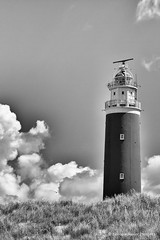 Lighthouse Eierland at Texel (Bianca Valkenier PhotoArt) Tags: sea summer blackandwhite bw cloud lighthouse beach strand island waddeneiland dunes nederland thenetherlands northsea zomer duinen vuurtoren texel noordholland cloudes eierland dutchnature worldheritageunescowaddensea