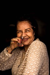 A smile confuses an approaching frown... (Just lovin' it) Tags: portrait smile mom drink cheers
