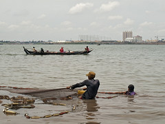 Family of Fishermen at the Mekong River near Phnom Penh, Cambodia (BenoitDemers) Tags: angkor asia asian boat boy buddhism buddhist cambodia cambodian child day dock fish fisherman fishing float girl home house khmer market national nature nautical people person pier poor poverty raft river row rural sap sea ship siem sky tonle tourism tradition traditional transport travel tropical vacation vietnam village water work cambodge