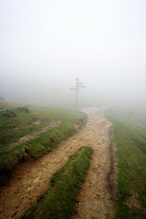 Signpost in the fog (Mimadeo) Tags: mist nature wet misty fog mystery lost dangerous haze spain europe european risk panel display path walk foggy hike direction spanish arrow signpost choice hazy information signboard orientation basque pathway basquecountry informational gorbea