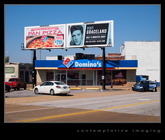 pizza, elvis, graceland and domino's (contemplative imaging) Tags: street city travel urban usa building sign architecture digital america buildings photography town photo midwest warm day tn image photos memphis tennessee structures elvis sunny images structure architectural billboard clear dominos pizza american april series imaging pan monday graceland 43 midwestern fourthirds shelbycounty 2013 olyep2 contemplativeimaging ronzack 20130401 p4016649
