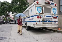 Behind Bar (John Fraissinet) Tags: street nyc newyorkcity woman ny newyork bus umbrella sony streetphotography correction nex7