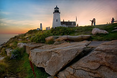 Vacationers at Sunset - in explore (SunnyDazzled) Tags: ocean travel family light sunset vacation portrait sky lighthouse tower beach nature station fence landscape coast rocks colorful cliffs shore wildflowers visitors pemaquid onlookers