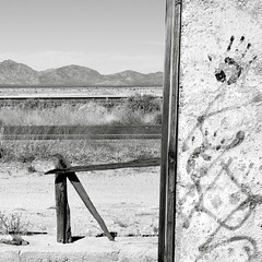 Modern rock paintings (kevin dooley) Tags: old arizona usa white mountain black southwest window rock modern graffiti us wooden highway desert post paintings cement peak az prison frame salome handprint 60 harcuvar
