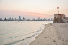 Bu Maher Fort |   (ZAKARiYA Abbas) Tags: old sea tree rock bahrain sand fort flag palm hotels bu maher manama muharraq