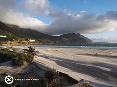 Hout Bay Late Sunday Afternoon (Jan-Krux Photography) Tags: africa light sea sky beach clouds strand landscape abend waves afternoon dunes south sunday himmel wolken windy olympus atlantic hills late sonne houtbay wellen westerncape zd windig 1240mm driftingsand